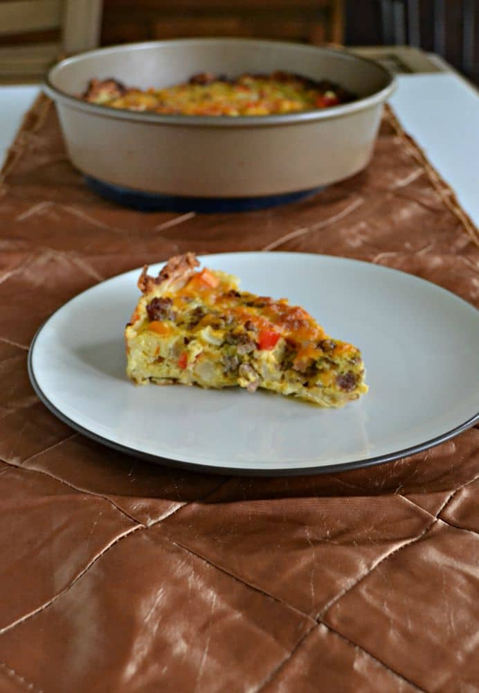 A delicious one pot Hash Brown Crusted Breakfast Quiche with eggs, cheese, vegetables, and sausage