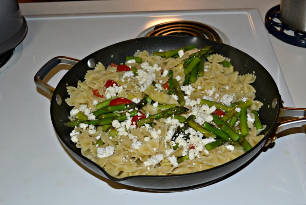 Lemon and Artichoke Pasta with fresh vegetables and cheeses.