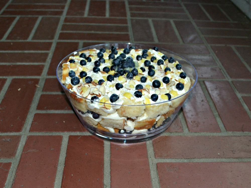 Lemon Blueberry Trifle made with layers of almond cake, homemade lemon curd, whipped frosting, and blueberries!