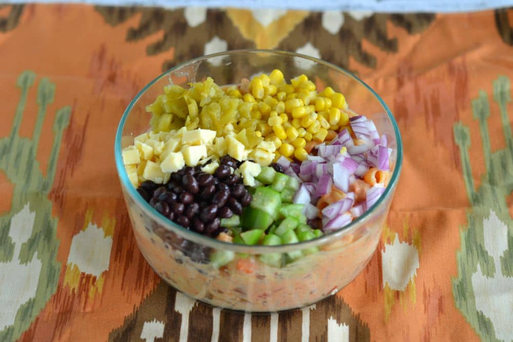 A brilliant Mexican Pasta Salad with onions, black beans, corn, cheese, and Sabra salsaonions, black beans,