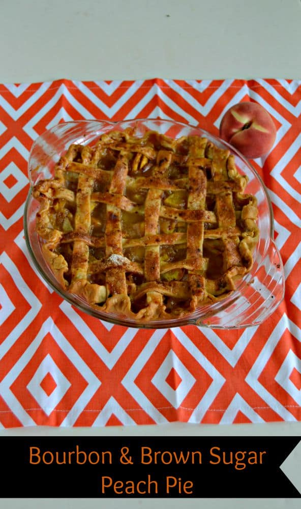 Juicy bourbon and brown sugar Peach Pie with a crispy brown pie crust