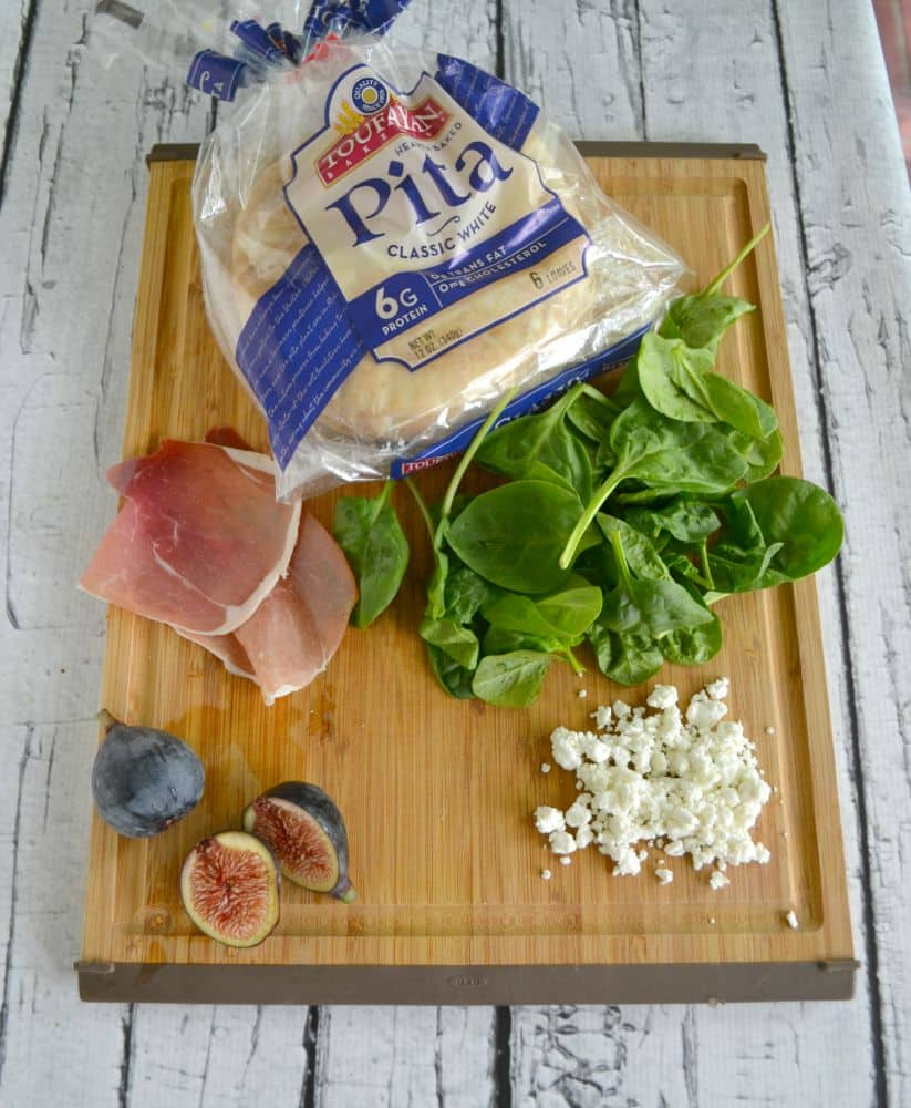 Delicious gourmet pita pizzas with prosciutto, spinach, and figs!