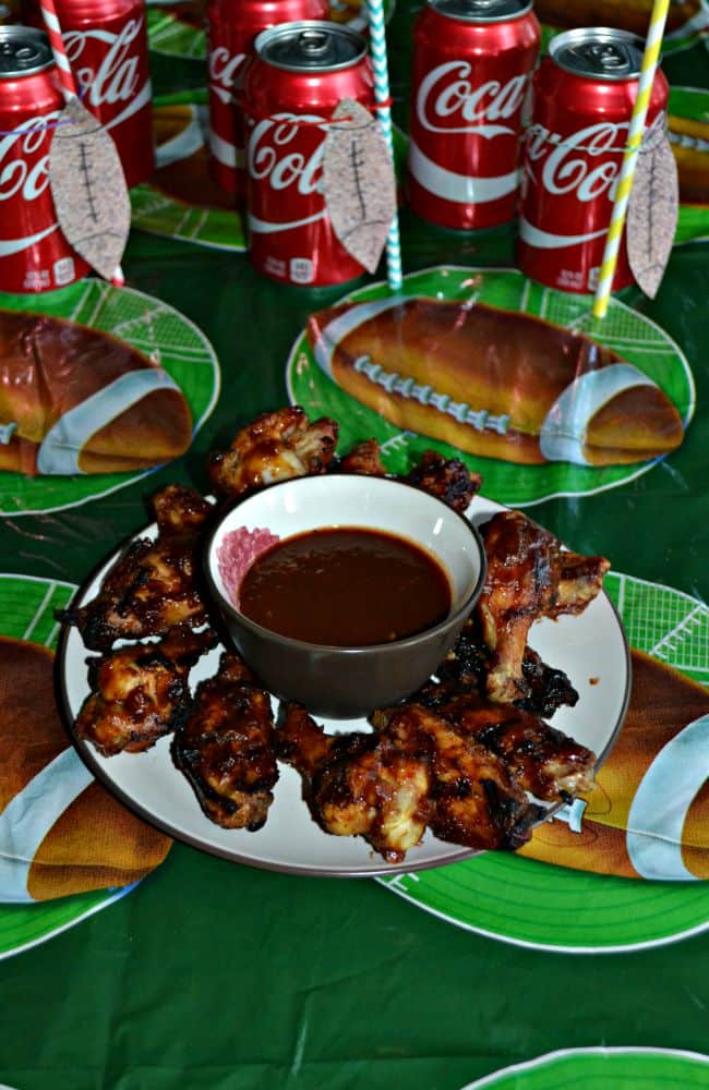 Need an easy Game Day appetizer? Check out these Grilled WIngs with sweet, smokey, and spicy Coca-Cola BBQ Sauce