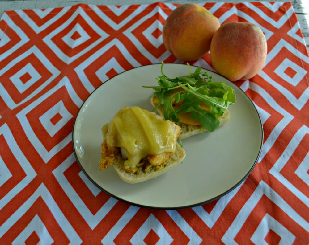 A delicious sweet and spicy sandwich made with Chicken, Peaches, and Arugula