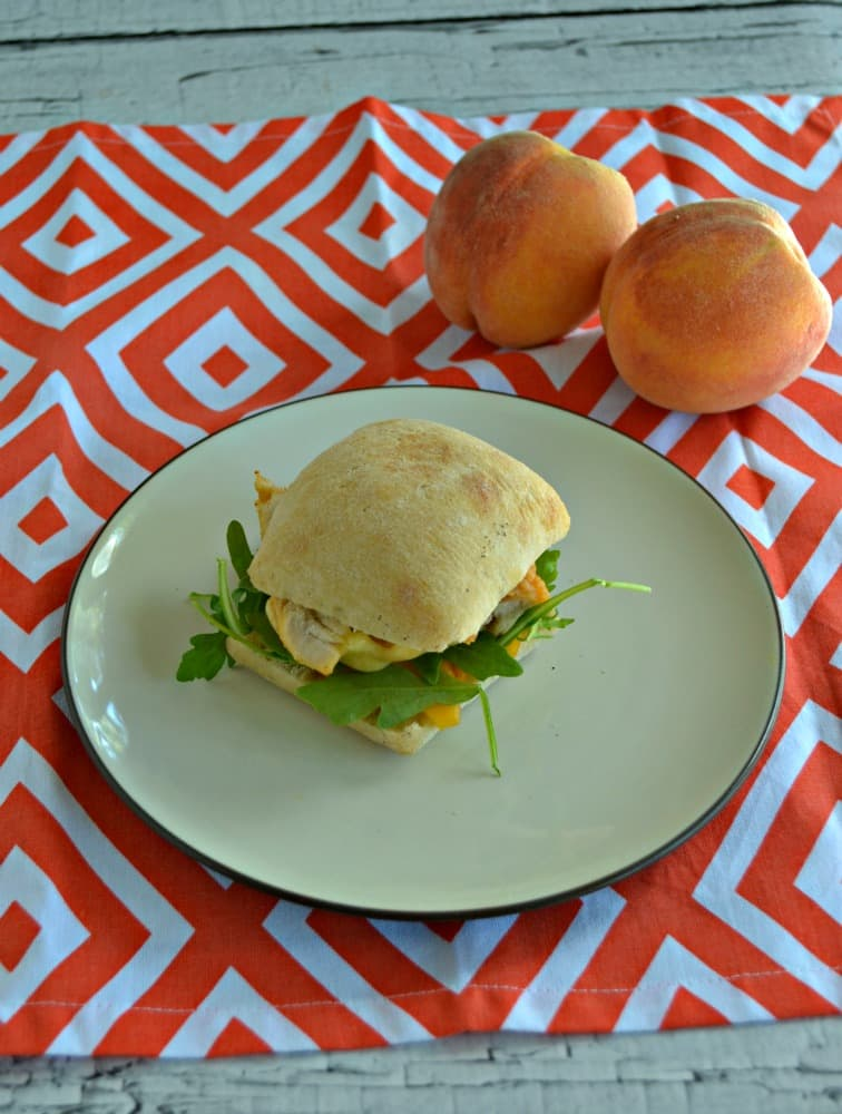 Take a bite out of this delicious Chicken, Peach, and Arugula Sandwich on a Foccacia Roll