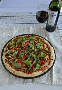 Make gourmet pizza at home with this Chorizo and Roasted Pepper Pizza with Arugula and a tasty glass of Gallo Family Vineyards Merlot