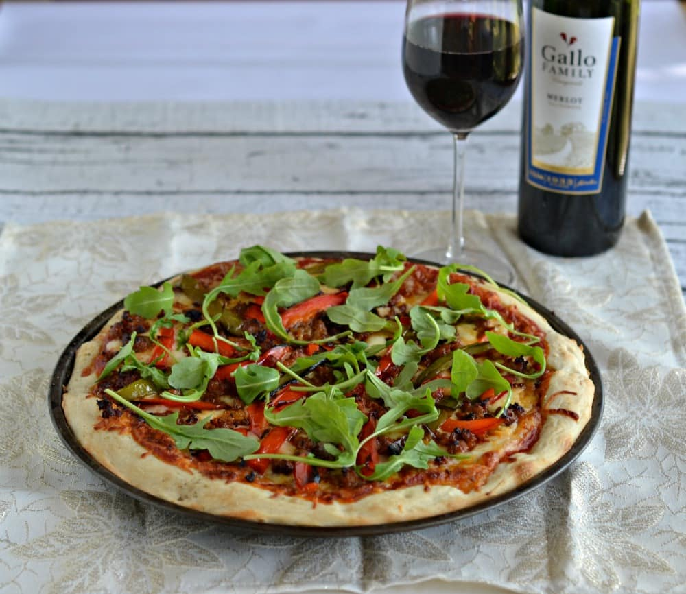 Love pizza? Then you need to make this Chorizo and Roasted Pepper Pizza with Arugula.