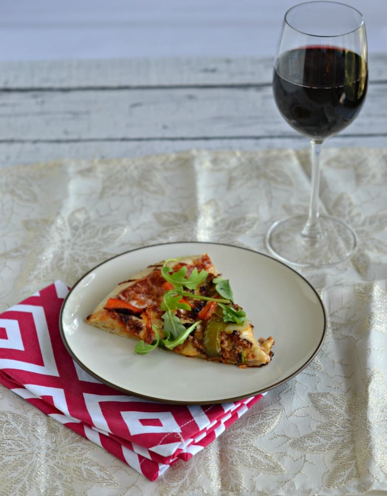 Grab a glass of Merlot with this spicy Chorizo and Roasted Pepper Pizza with Arugula