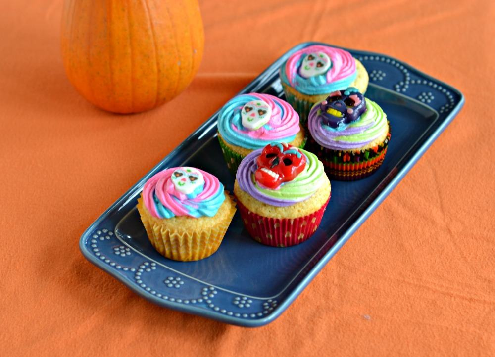 Fun Vanilla Flavored Cupcakes with multi-colored frosting makes the perfect Sugar Skull Cupcakes for the Day of the Dead