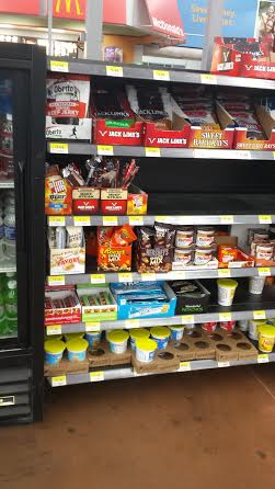 Find goodnessknows snack squares near the cash register!