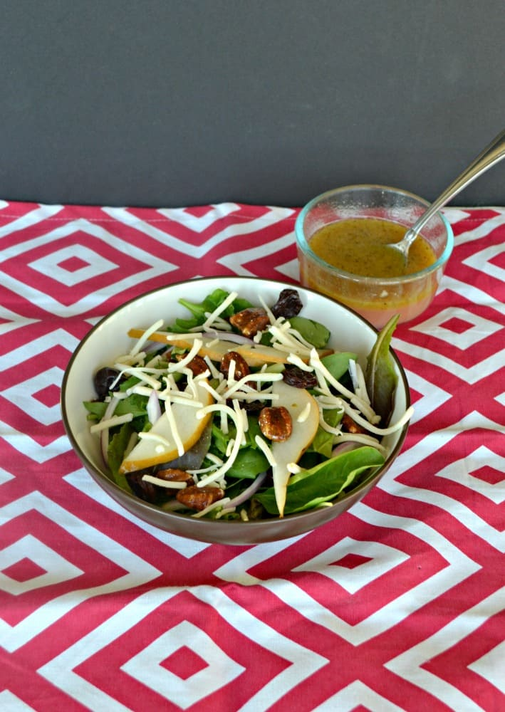 Delicious Winter Salad combines pears, dried cherries, pepper jack cheese, and a citrus vinaigrette.
