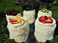 Individual Angel Food Cakes with Lemon Curd Filling and Topped with Vanilla Bean Frosting and Fresh Fruit