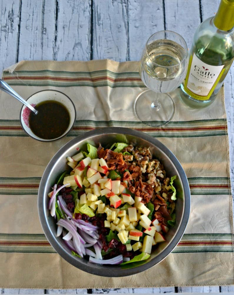 Harvest Salad is a tasty combination of lettuce topped with red onions, cheese, walnuts, and cranberries with a homemade vinaigrette then paired with Gallo Family Vineyards Pinot Grigio