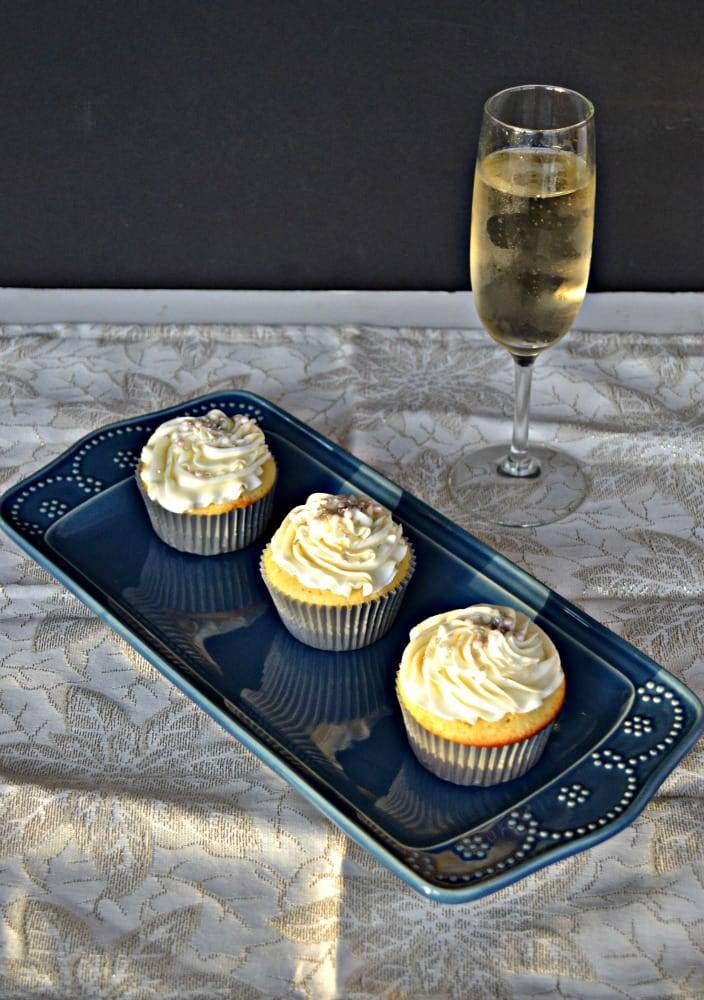 Delicious Vanilla Cupcakes topped with fluffy Champagne Frosting are perfect for New Year's Eve!