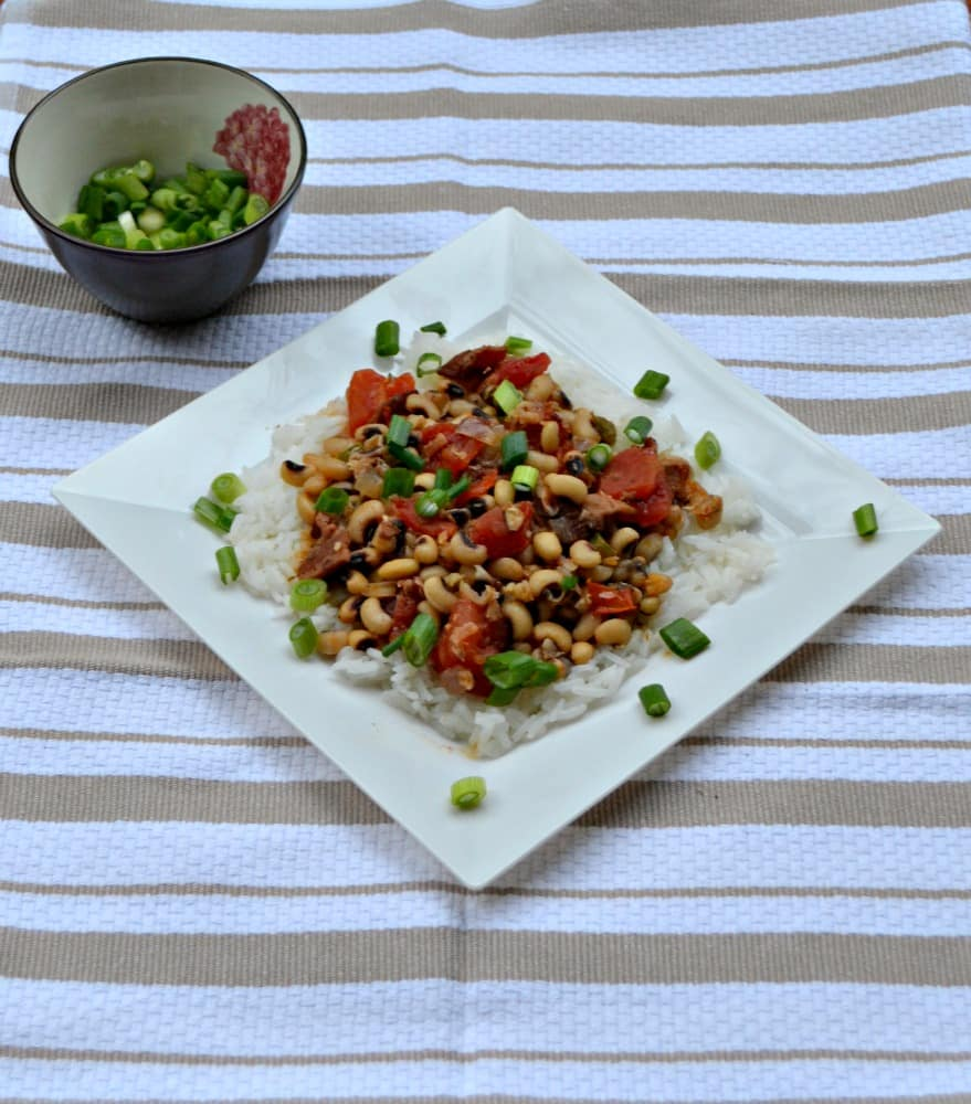 Hoppin John is a traditional southern dish made with black eyed peas, vegetables, Cajun seasoning, and rice