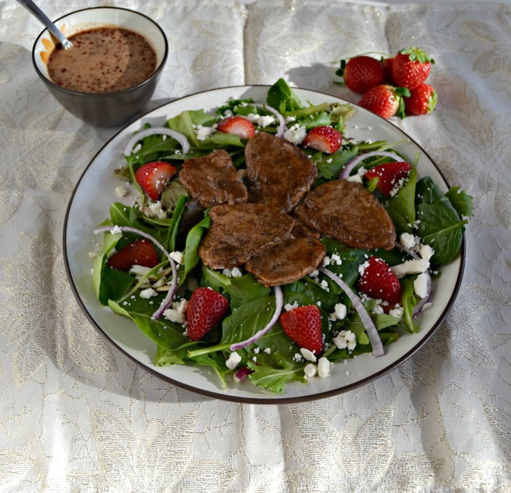 Enjoy a delicious Balsamic Pork Salad with Strawberries and Goat Cheese drizzled with Balsamic Strawberry Vinaigrette
