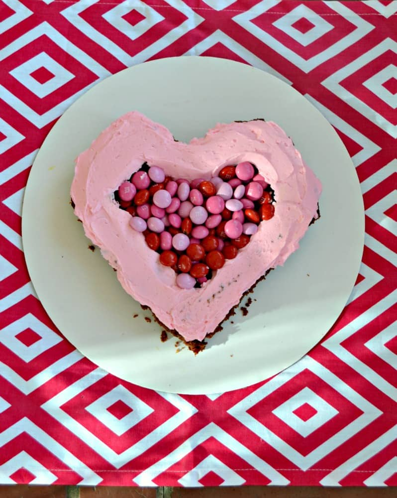 FIlled a Chocolate Cake with pink frosting and M&M's® Strawberry for a Valentine's Day surprise treat!