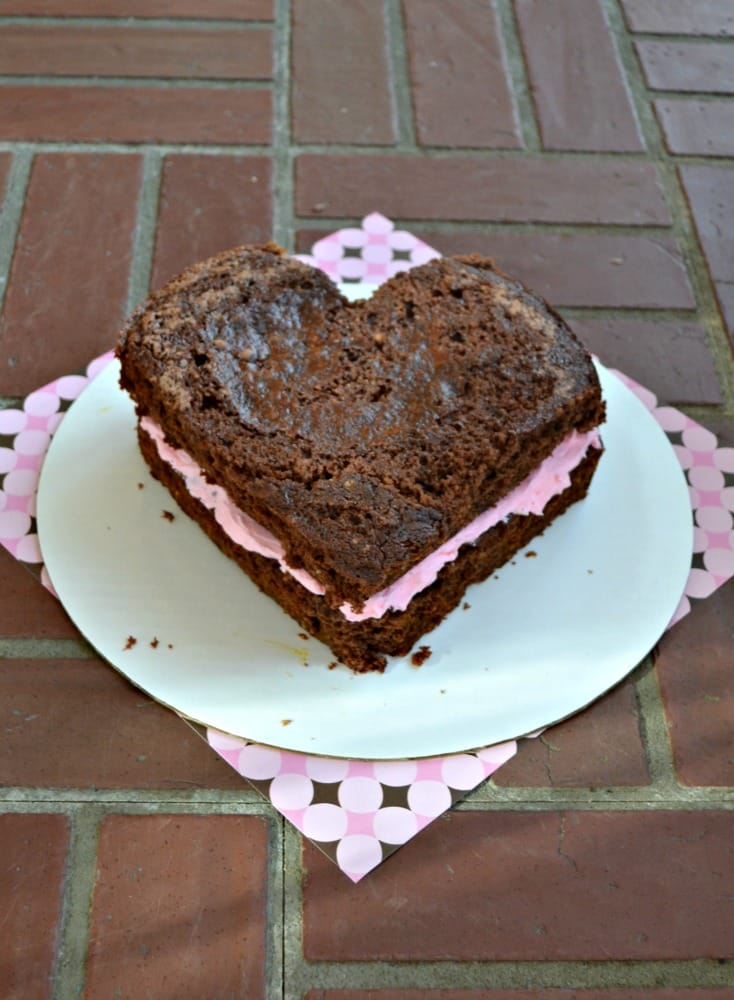 Delicious chocolate cake filled with pink frosting and M&M's® Strawberry