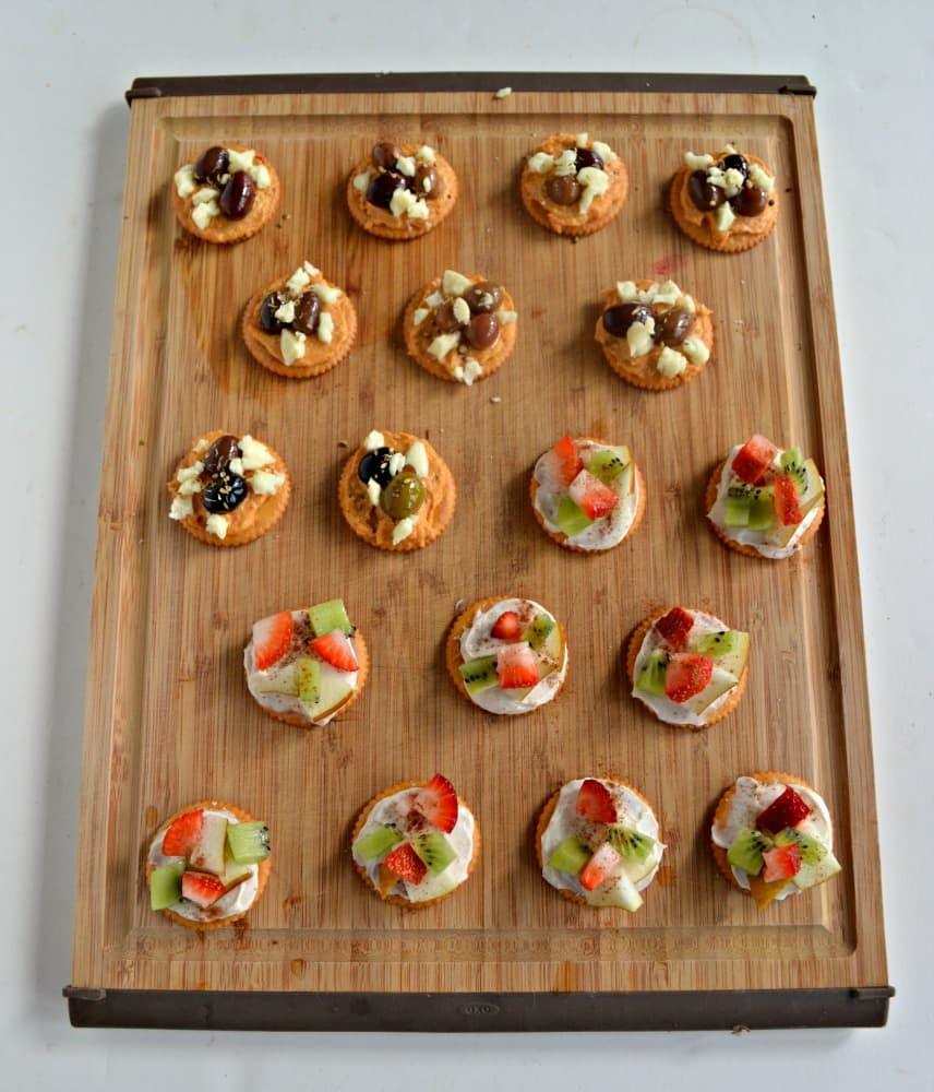 Two delicious Game Day snacks on one tasty RITZ cracker! Fruit tarts and Mediterranean appetizers are perfect together.