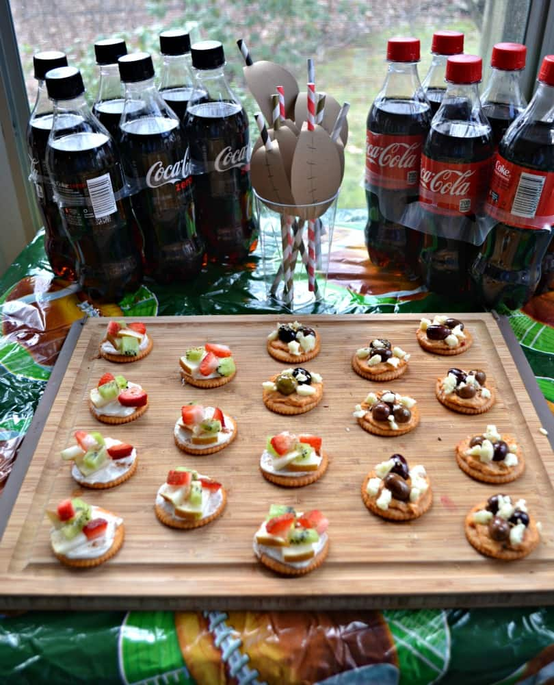 Love these fun RITZ cracker fruit tarts and Mediterranean Appetizers served with Coke Zero for a Game Day snack.