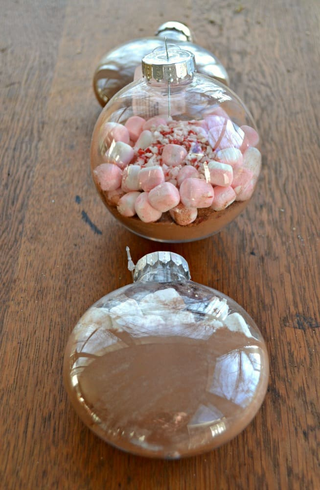Enjoy Hot Chocolate ornaments on your tree or in your mug with two tasty flavors!