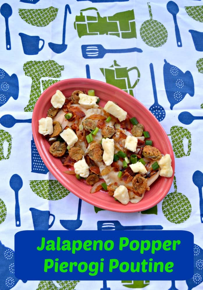 Jalapeno Popper Pierogi Poutine tops homemade pierogies with fried jalapenos, crispy bacon, cheese curds, and green onions.