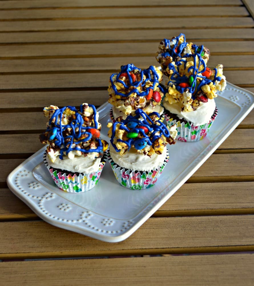 Movie Theater Cupcakes combine chocolate cupcakes with Coca-Cola frosting and Popcorn Balls with M&M'S on top!