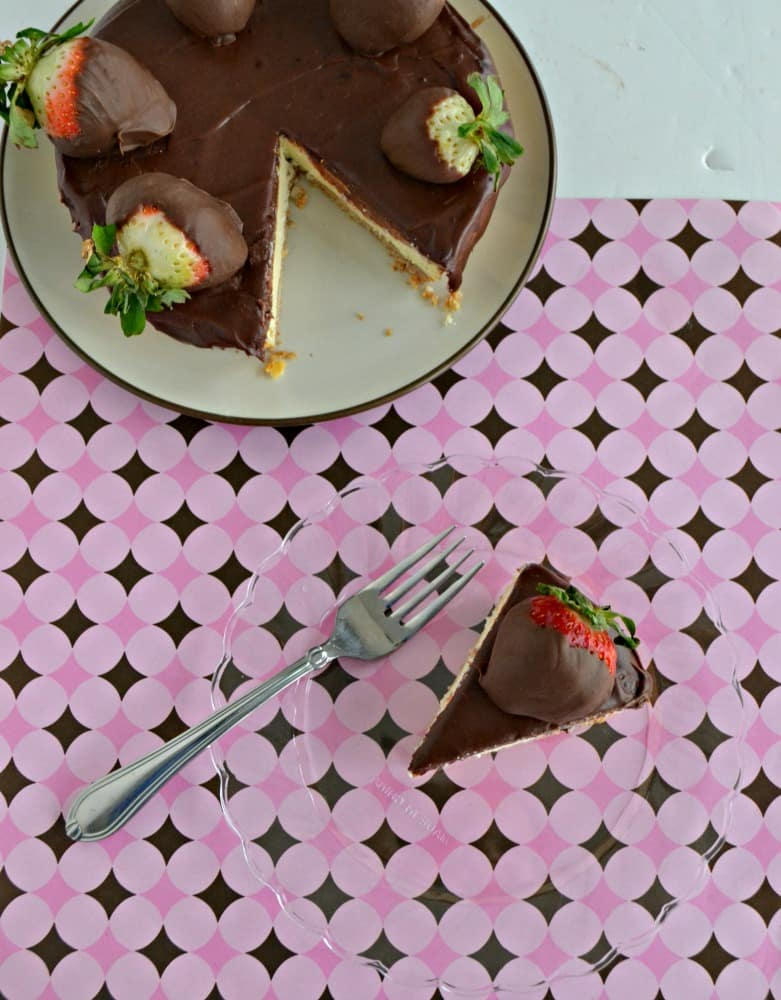 Enjoy a slice of this tasty Chocolate Covered Strawberry Cheesecake.