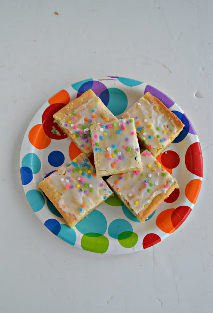 These Funfetti Cookie Bars are fun for all celebrations with rainbow sprinkles in the batter and on thee top!