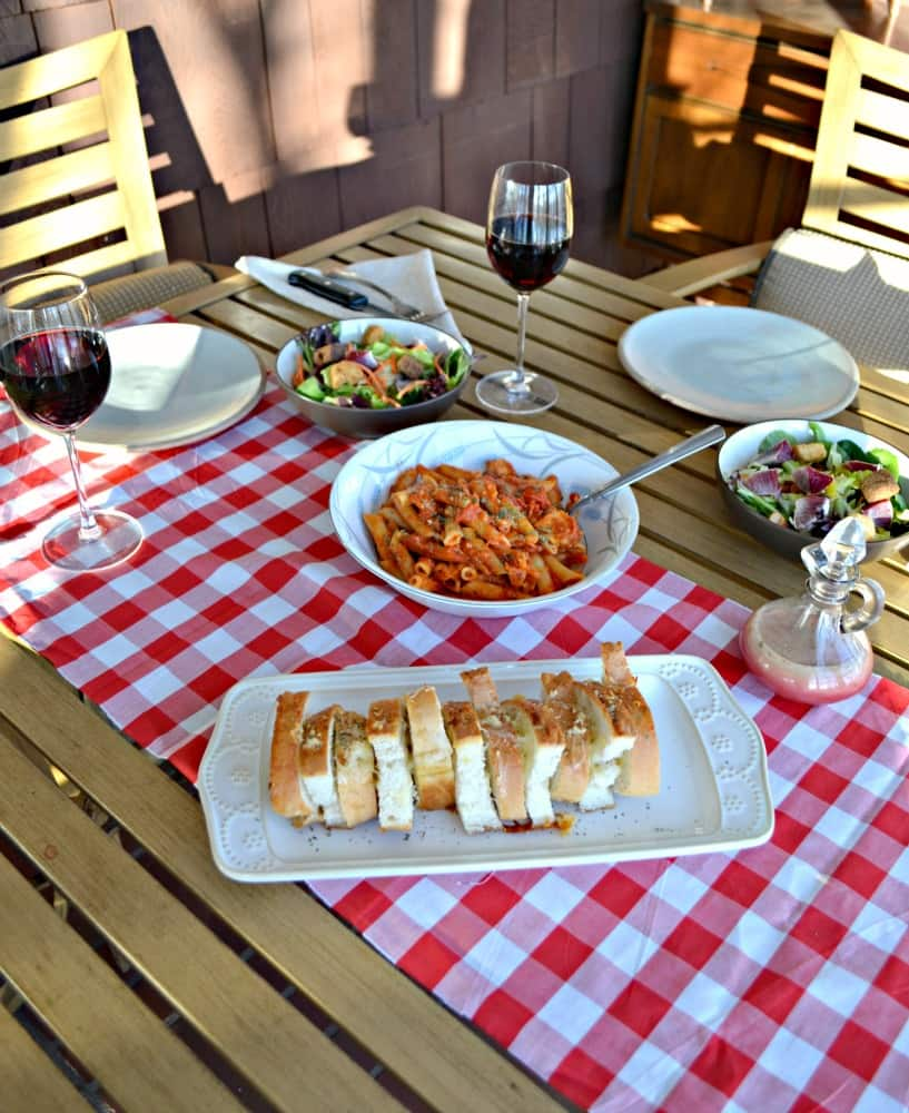 Mangia this Italian way with pasta, Easy, Cheesy Pull Apart Bread, wine, and a winter salad with homemade dressing