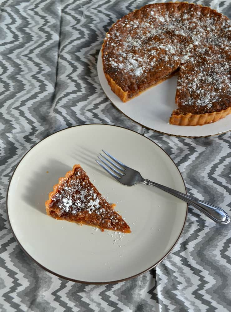 Check out this delicious and simple recipe for Brown Sugar Pie with powdered sugar on top!