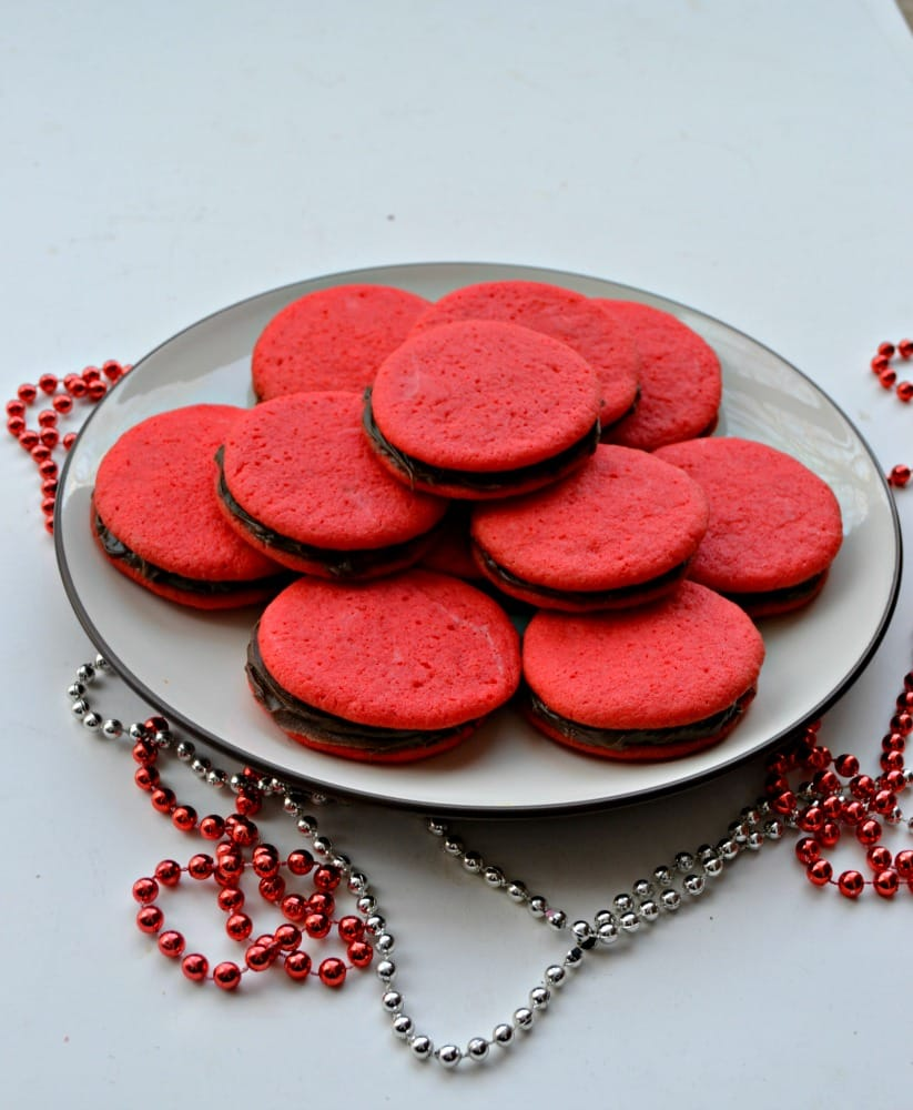 Enjoy these fun Red Sandwich Cookies filled with Chocolate for the holidays!