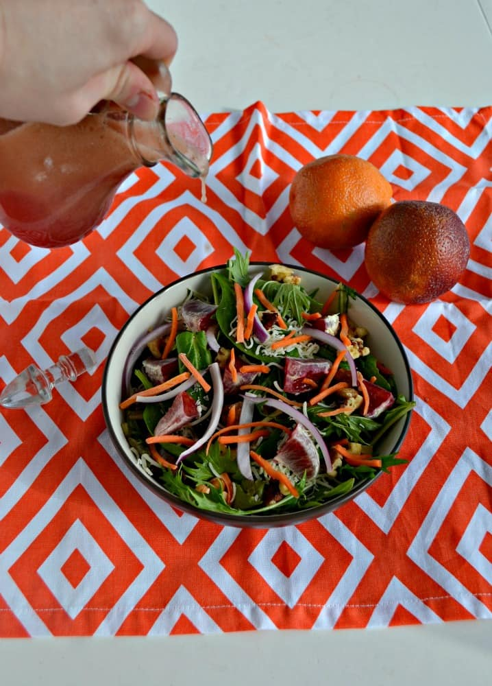 Make yourself a hearty Winter Salad with onions, nuts, blood oranges, and cheese along with a homemade Blood Orange Vinaigrette