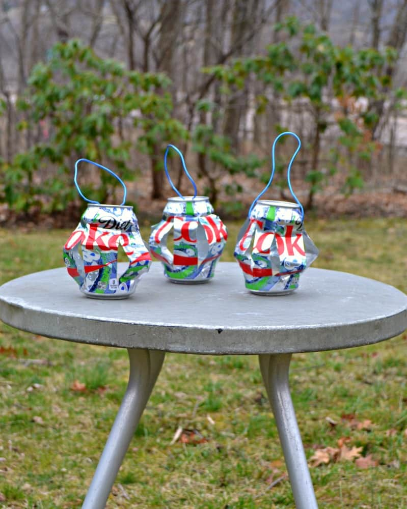 Love upcycling and these DIY Hanging Tea Light Holders are made with Diet Coke cans!