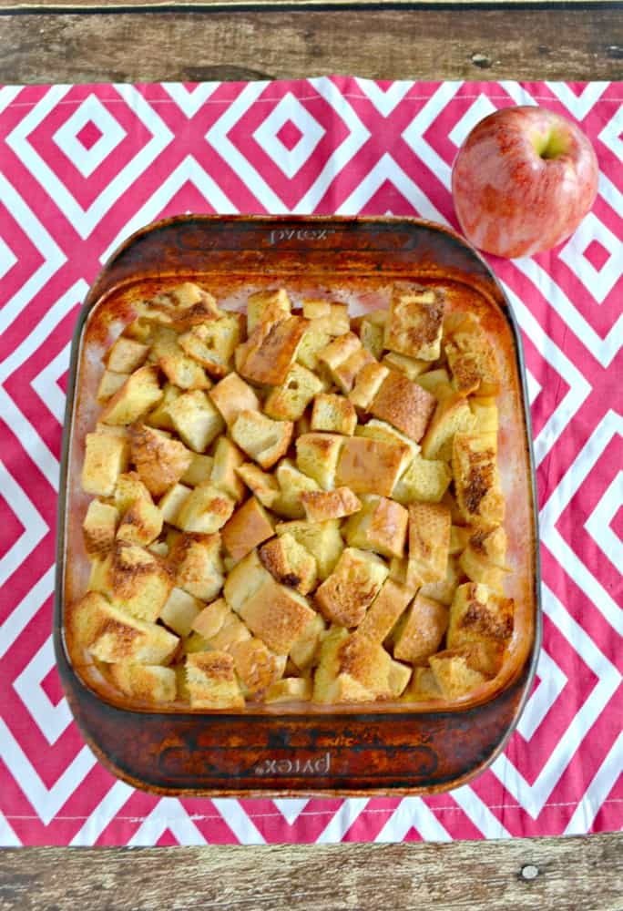 Delicius Apple Bread Pudding has a delicious custard layer on the bottom, apples in the middle, and firm toasted bread pieces on top and then in served with Butterscotch Sauce