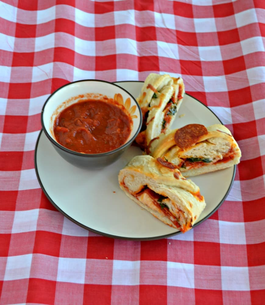 Slice up this freshly baked Braided Pepperoni Pizza Bread and serve with marinara sauce