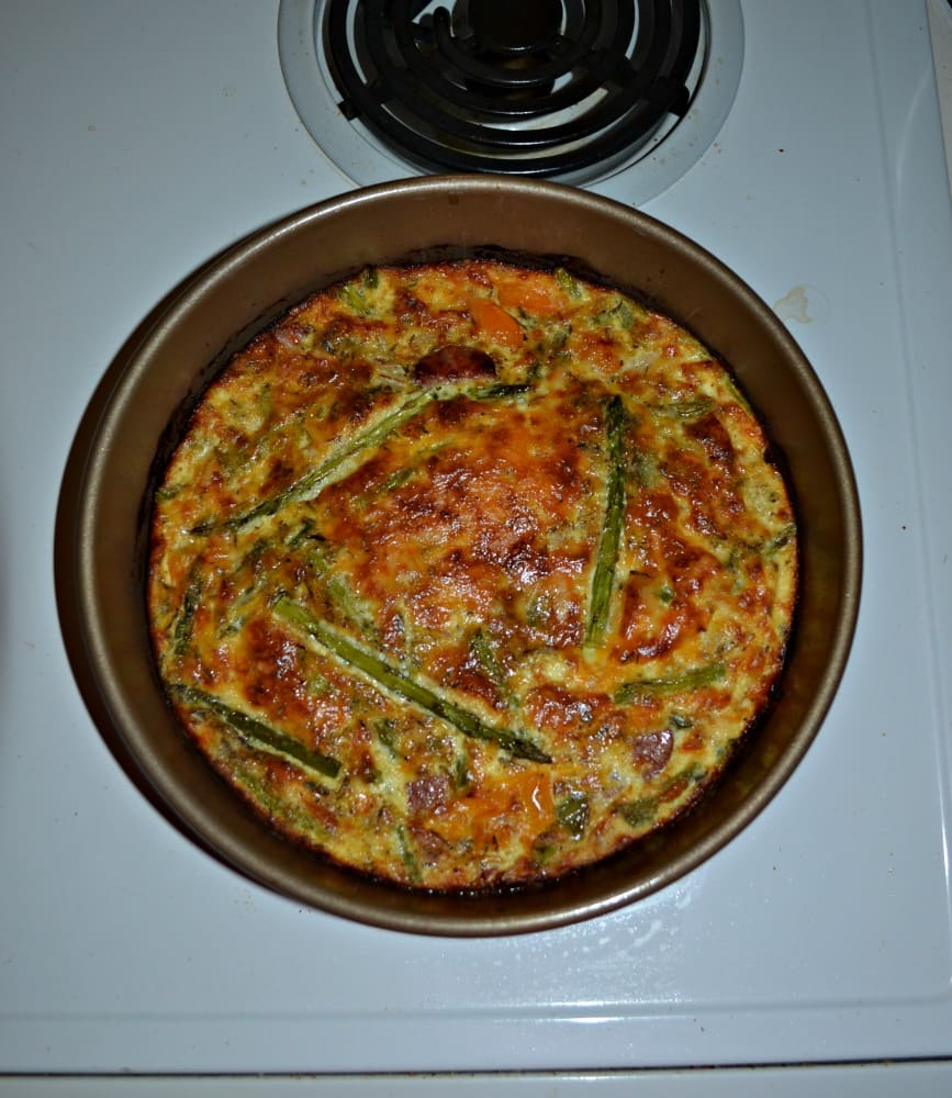 Make an easy and delicious dinner with this Crustless Quiche with Asparagus, Kielbasa, and Peppers