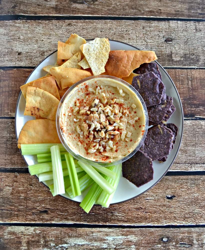 "Need an ""unofficial meal"" mid-day? Try Sabra Hummus topped with Walnuts and Ginger then served with celery, pita chips, and tortilla chips."