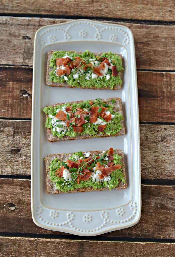 It only takes a few minutes to make these delicious Spring Pea and Green Onion Crostini bites!