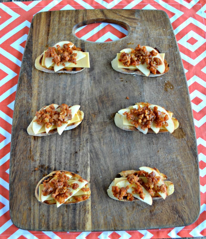 Sweet, spicy, and flavorful, these Apple, Chorizo, and Manchego Crostini are a tasty appetizer