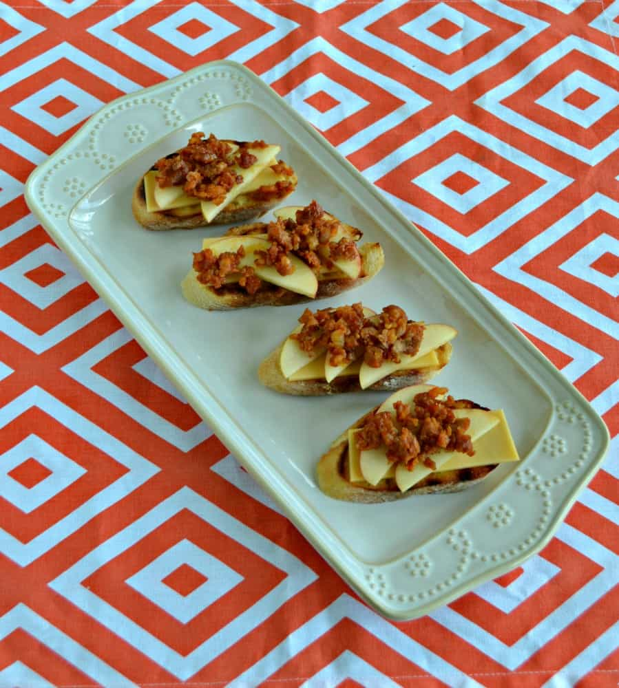 Crunchy crostini topped with apples, chorizo, and Manchego