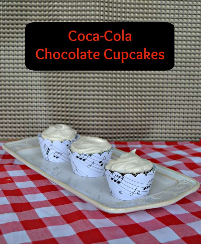 These Coca-Cola Cupcakes with sheet music liners are a fun way to Share a Song with Coke!