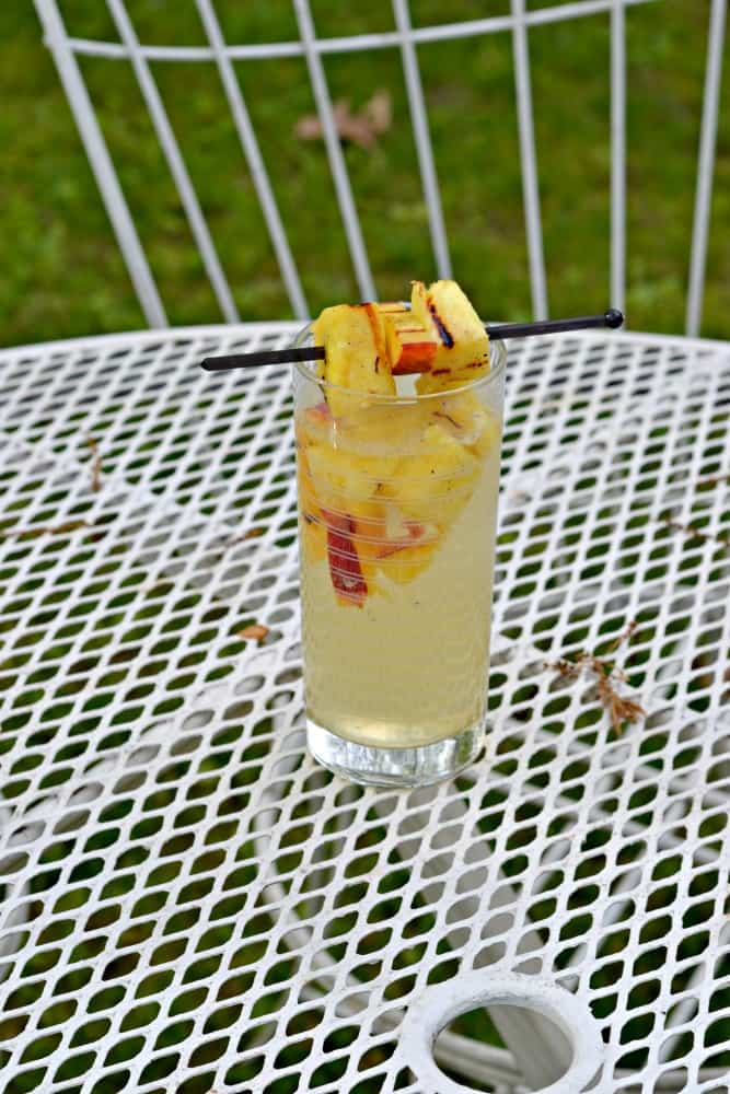 Grab a tall glass of Grilled Peach and Pineapple Sangria and relax this summer