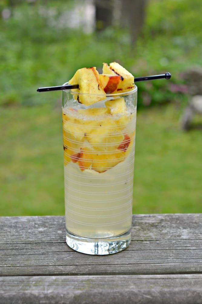 "Nothing says summer like grilling and this Grilled Peach and Pineapple Sangria Recipe is a great way to start your picnics and BBQ""s"