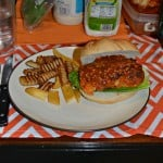 Make a delicious Buffalo Chicken Sandwich at home by pan frying, finishing off in the oven, and tossing with a delicious buffalo sauce