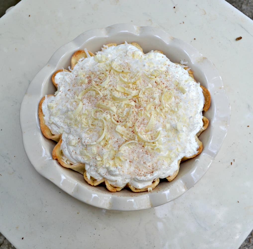 Love this Coconut Cream Pie with fresh whipped cream and topped with white chocolate and coconut