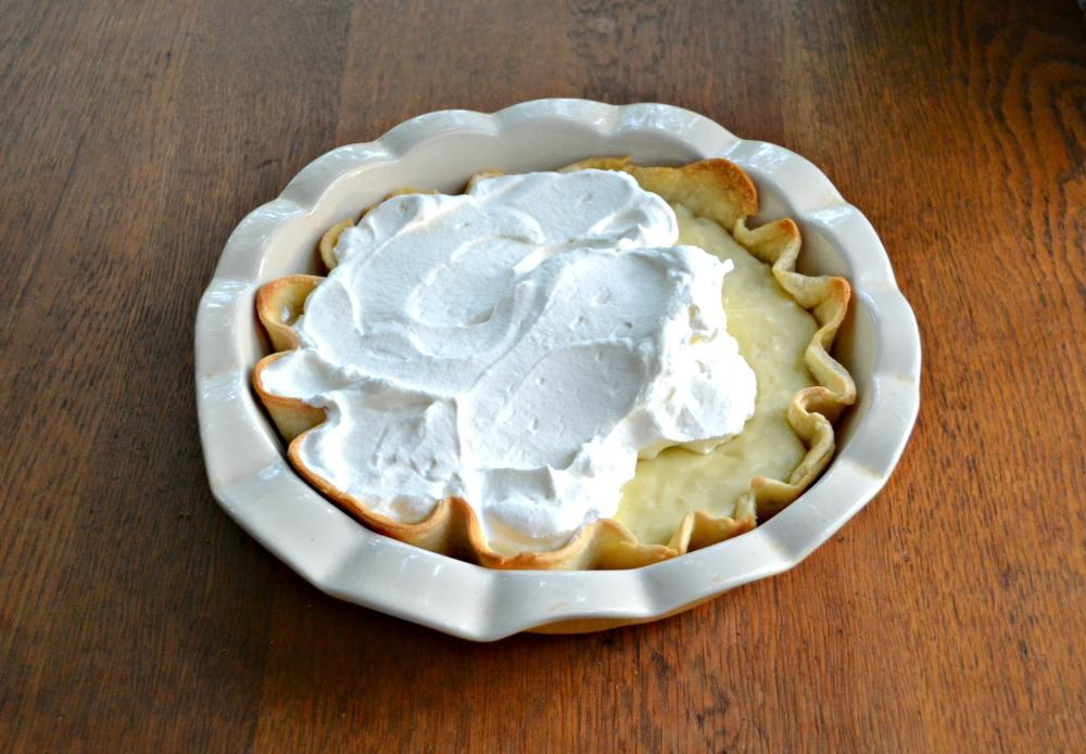 Pour fresh whipped cream over top of your Coconut Cream Pie