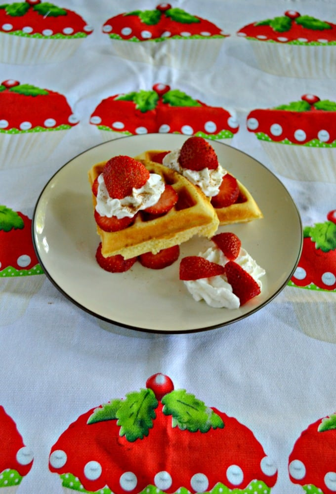 Take a bite out of these Strawberry Shortcake Waffles with fresh strawberries