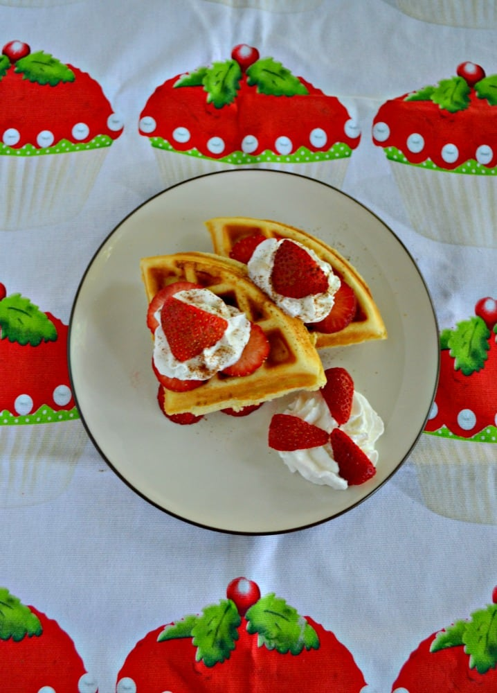 Delicious vanilla waffles with fresh strawberries and cinnamon whipped cream made the most delicious Strawberry Shortcake Waffles!
