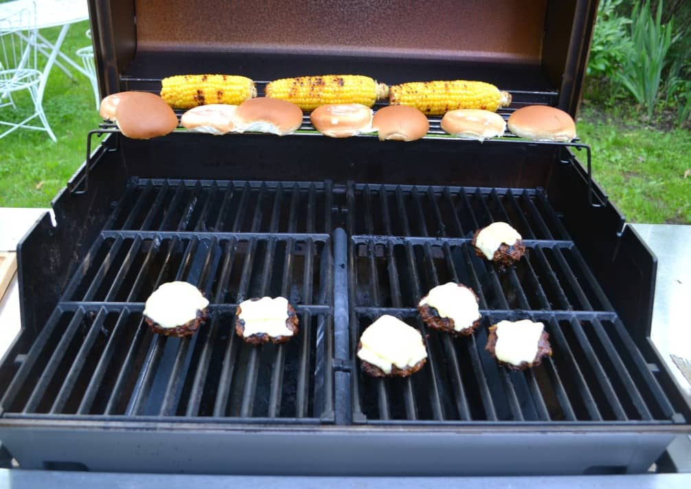 Grill juicy burgers, top them with cheese, then brush them with a homemade BBQ sauce.